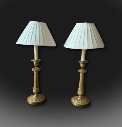 A pair of early 19th century French candlesticks lamps