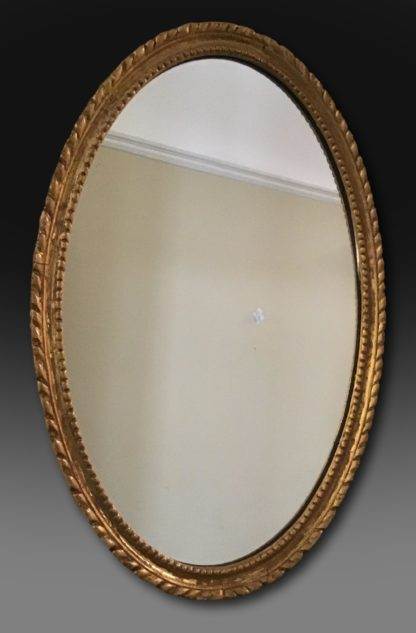 Mid 19th century giltwood mirror of small size with original gilding. The original glass has been replaced but can be supplied. English C1865